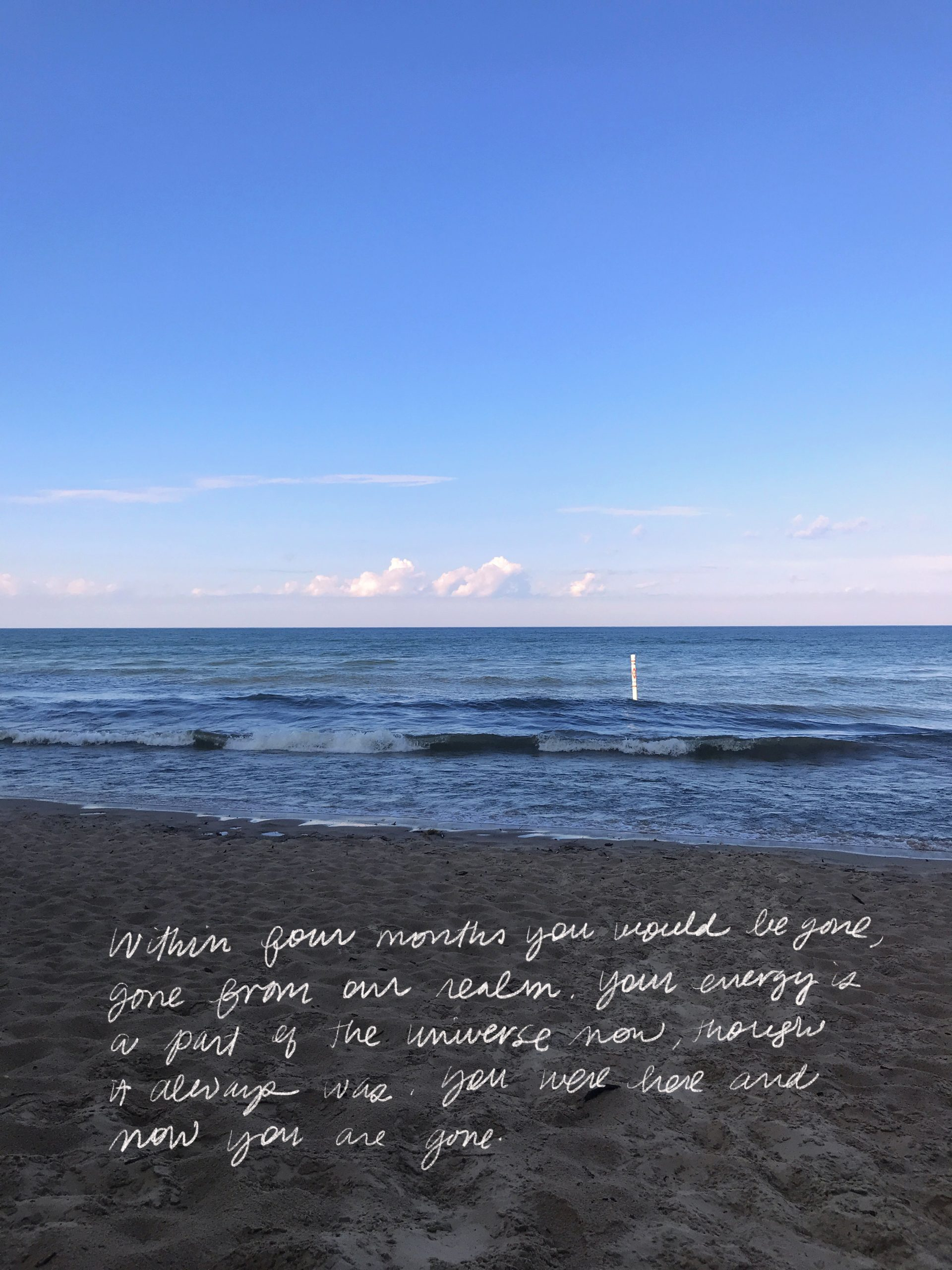 Image of photograph of Lake Michigan, buoy and beach with handwritten text.